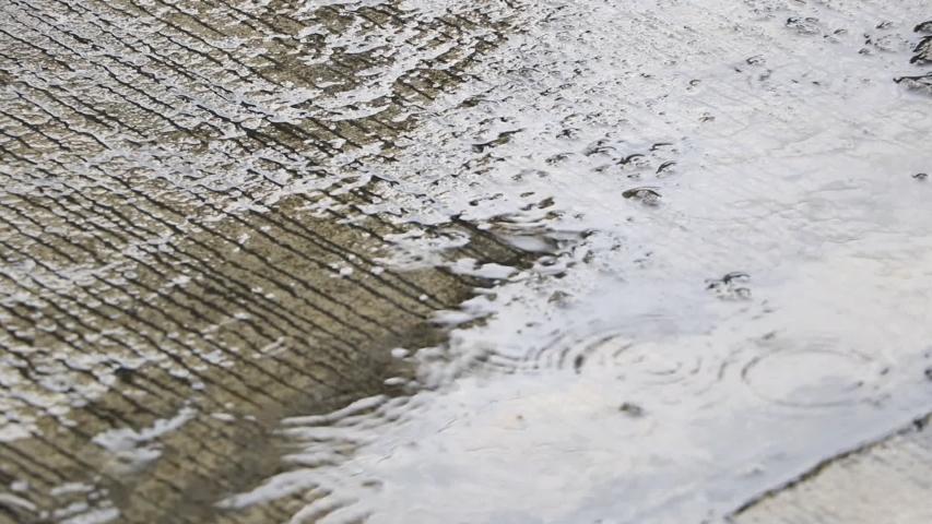 The Heavy rain drops on concrete floor  | Shutterstock HD Video #1035422879