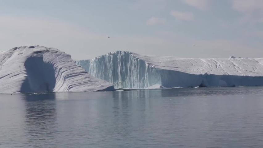 Ilulissat/Greenland  08/19/2019 photo of Large Iceberg Breaking in Greenland | Shutterstock HD Video #1035484919