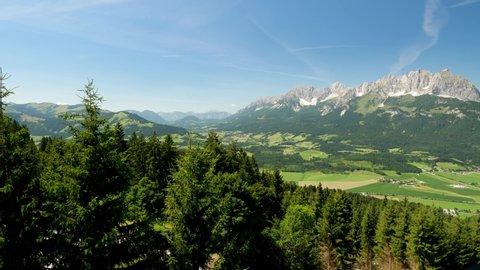 Beautiful alpine landscape with green meadows, alpine mountain peaks, St johan, Tyrol Alps, Austria