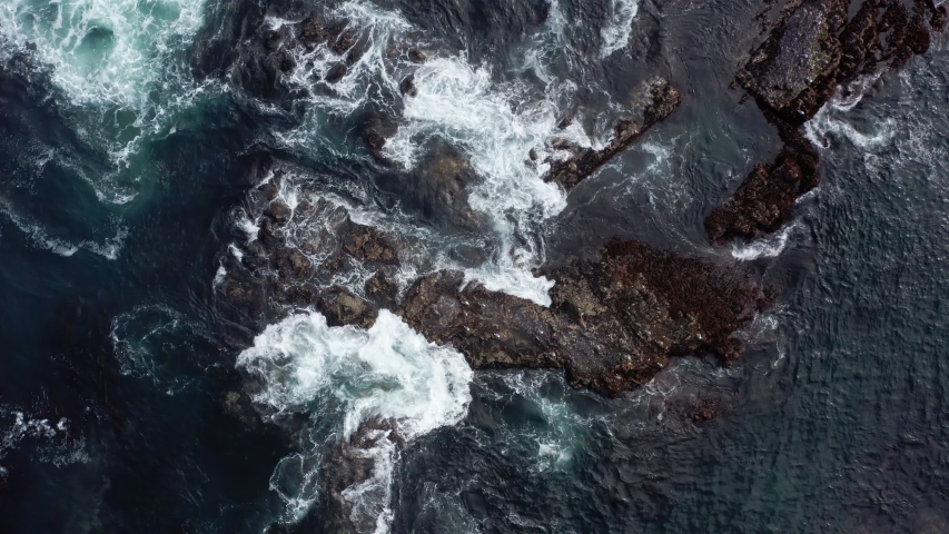 Top down aerial view of giant ocean waves crashing and foaming | Shutterstock HD Video #1035544529