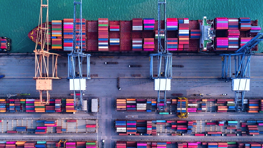 4K Timelapse of modern industrial port with containers from top view or aerial view. It is an import and export cargo port where is a part of shipping dock.Singapore | Shutterstock HD Video #1035563069