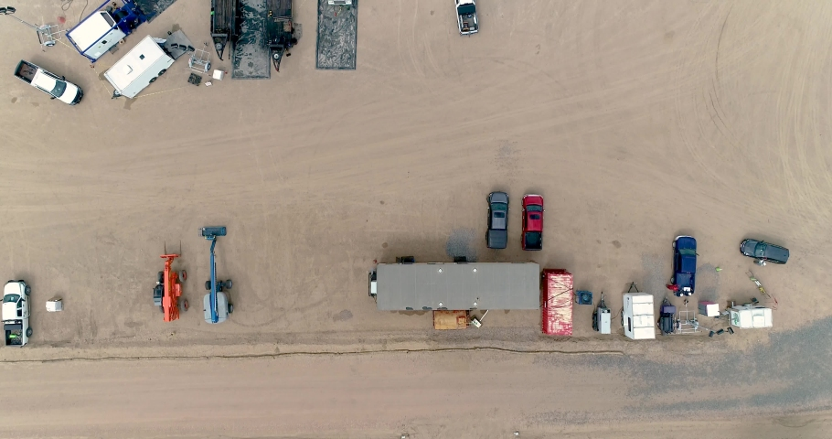 A drone flyover of the fracking operation utilizing directional drilling and other advanced technologies. | Shutterstock HD Video #1035578489