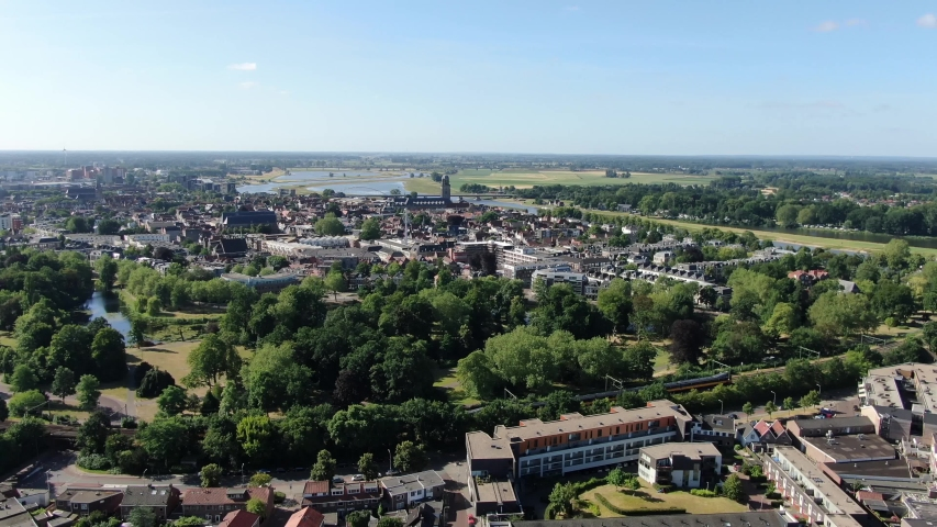 Aerial tracking shot of train driving over ijssel river by viaduct infrastructure in Deventer, the Netherlands   Shutterstock HD Video #1035788339