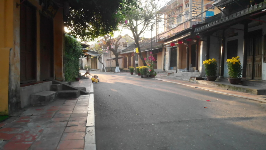 Walk through empty streets of Hoi An ancient town at sunrise | Shutterstock HD Video #1035998249
