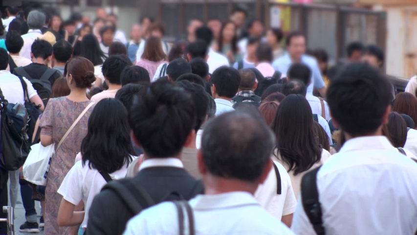 UMEDA, OSAKA, JAPAN - CIRCA JULY 2019 : View of crowd of people walking down the street in busy rush hour. Many commuter walking near Osaka train station after work. Slow motion shot in early evening.   Shutterstock HD Video #1036013099