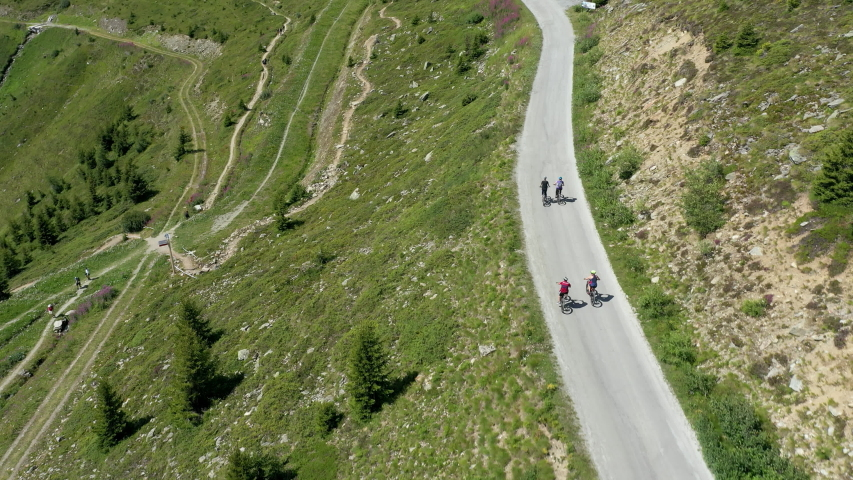 An aerial video of a mountainbiker riding a beautiful trail in Switzerland. This video was filmed near Verbier. | Shutterstock HD Video #1036086809