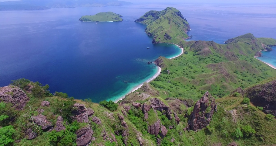 Aerials Flores Komodo National Park includes Island of Padur, Rinca and Pink Beach and Island Villages, Tourist boats and Mountain/Beach Views | Shutterstock HD Video #1036176119