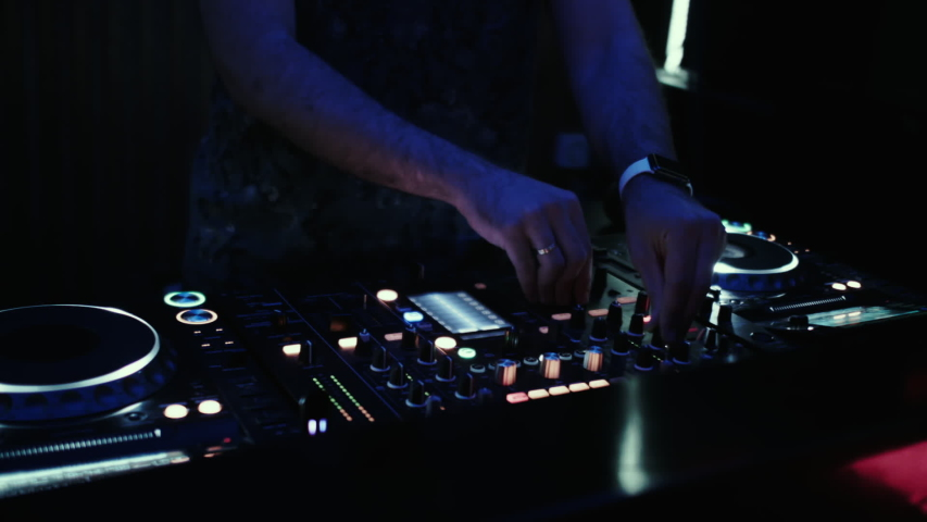 DJ at the console mixes music in a night dance club.  | Shutterstock HD Video #1036333679