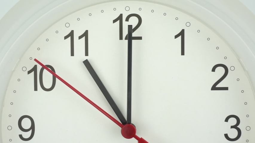 The beginning of time 11.00 am or pm, Closeup White wall clock Red second hand minute Walk slowly, Time concept. | Shutterstock HD Video #1036338749