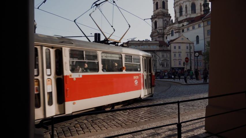 Two old red trams passing through square in Prague | Shutterstock HD Video #1036360709