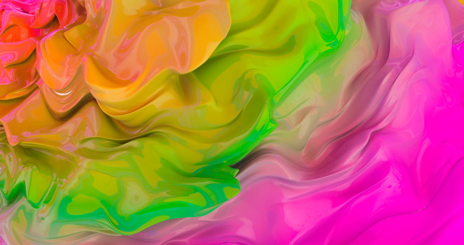 Rainbow glossy liquid waves rotating footage. Vibrant multicolor paint flow on spinning shape surface. Iridescent blurry fluid seamless abstract animation. Mixed paint psychedelic looped video #1036373489