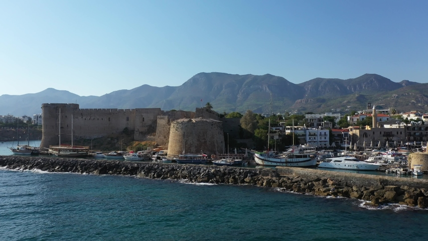 Kyrenia (Girne) is a city on the north coast of Cyprus, known for its cobblestoned old town and horseshoe-shaped harbor. | Shutterstock HD Video #1036395359