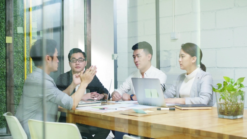 Group of young asian entrepreneurs discussing business in company meeting room | Shutterstock HD Video #1036633289