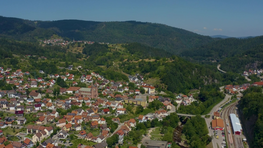Aerial view of the city Forbach in Germany, on a sunny day in summer. Wide view with zoom in. | Shutterstock HD Video #1036729529