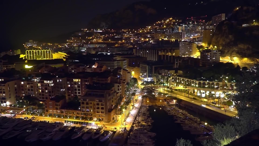 Night in the monaco timeslamps. Evening sunset lights. White yachts. Colorful sky. Romantic evening in Montecarlo. Cote d'Azur. Mediterranean Sea. City in the evening. | Shutterstock HD Video #1036842959