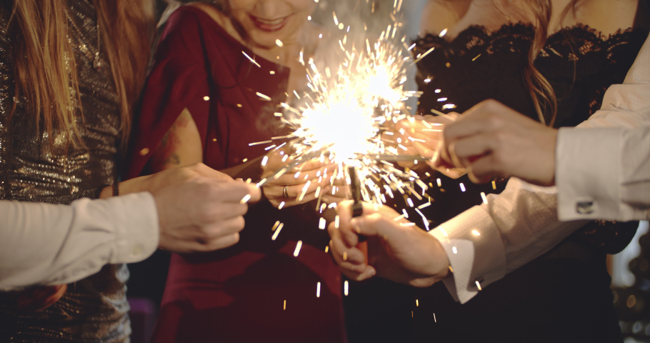 Party fun. Group of friends celebrating night party with fireworks in hand. Glamorous, stylish people enjoying holiday spending together. Friendship, entertainment, diversity, birthday reunion concept   Shutterstock HD Video #1036893749