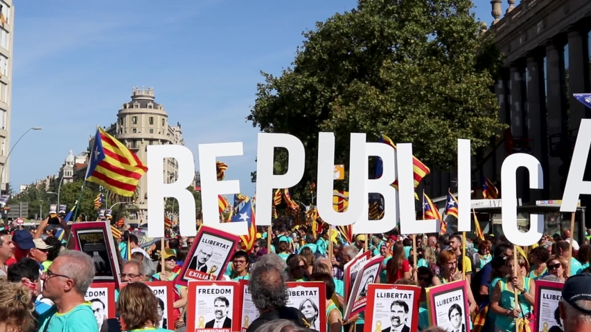 Barcelona, Catalonia / Spain - September 11, 2019: Catalan independentist protesters holding Republica word banners at a rally during la Diada, Catalonia's National Day.
