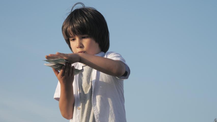 Cute boy throwing money euro banknotes. | Shutterstock HD Video #1036963199