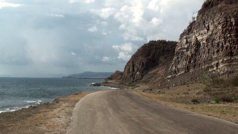 Pilon, Granma,  /Cuba- january 9, 2019:  Eroded road on the scenic coastal road  between Santiago de Cuba and Pilon .