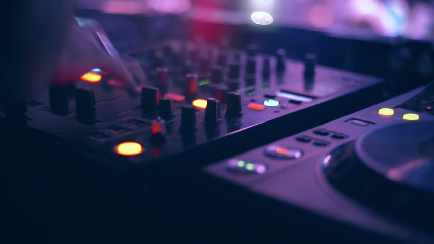 DJ mixing in the mixer, people feeling the vibration of the music | Shutterstock HD Video #1037112929
