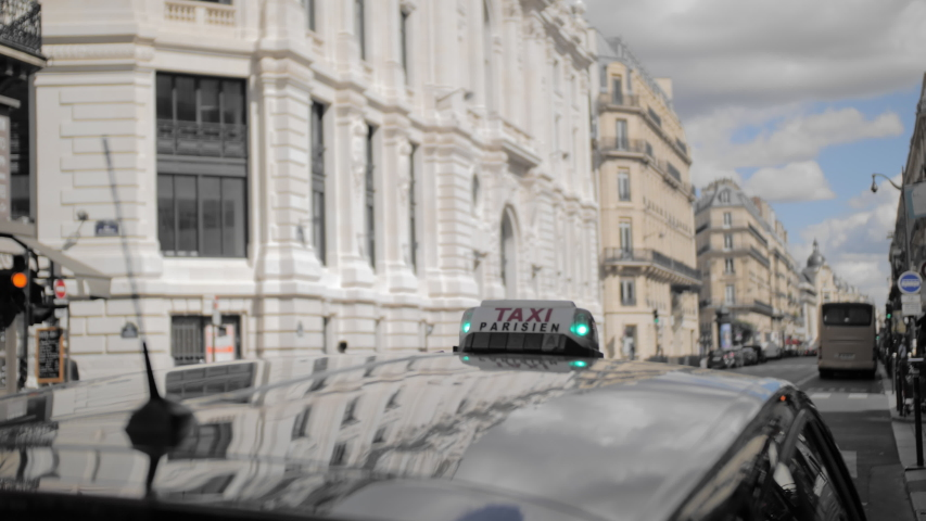 Paris taxi. Lights green, taxi free. Against the background of a blurred urban landscape. Close-up. Slow Motion. | Shutterstock HD Video #1037140139