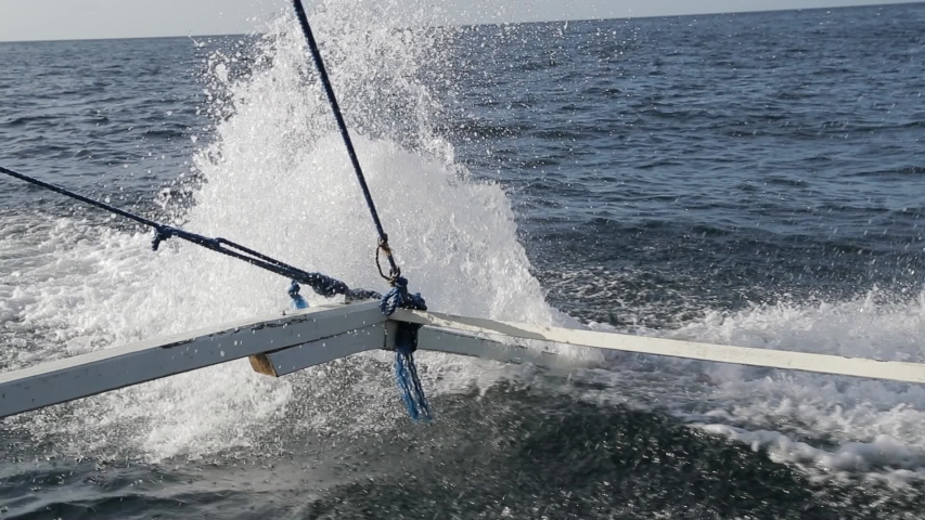 Water splash and sprays coming from Philippines boat with tourists.   #1037159159