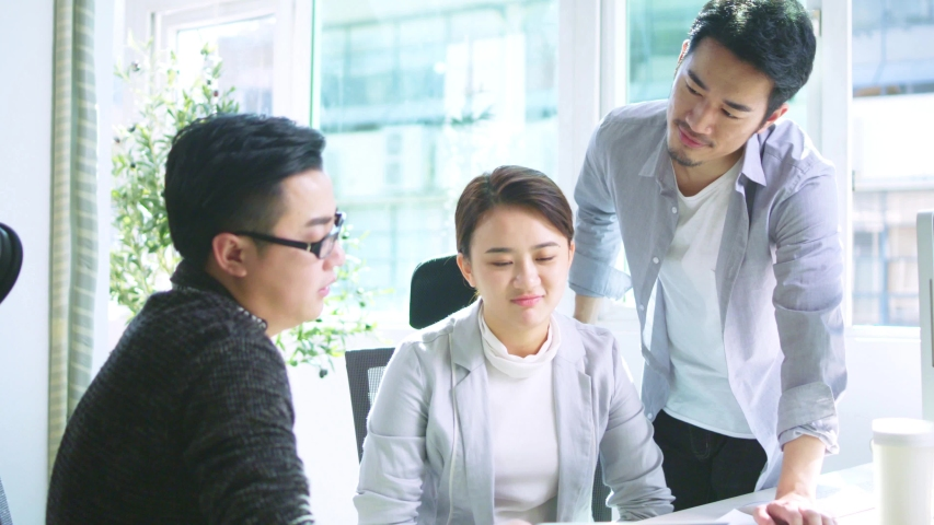 Two asian business men and a business woman meeting in office | Shutterstock HD Video #1037186579