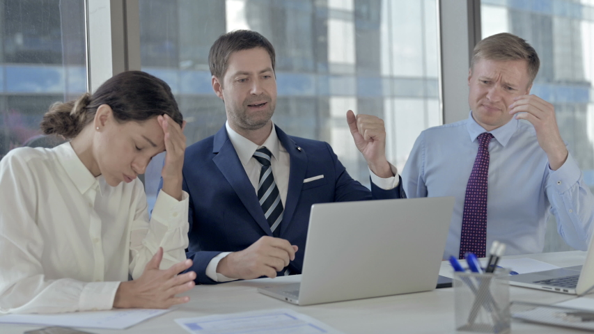 Executive Business people get Shocked while using Laptop on Office Table | Shutterstock HD Video #1037296379