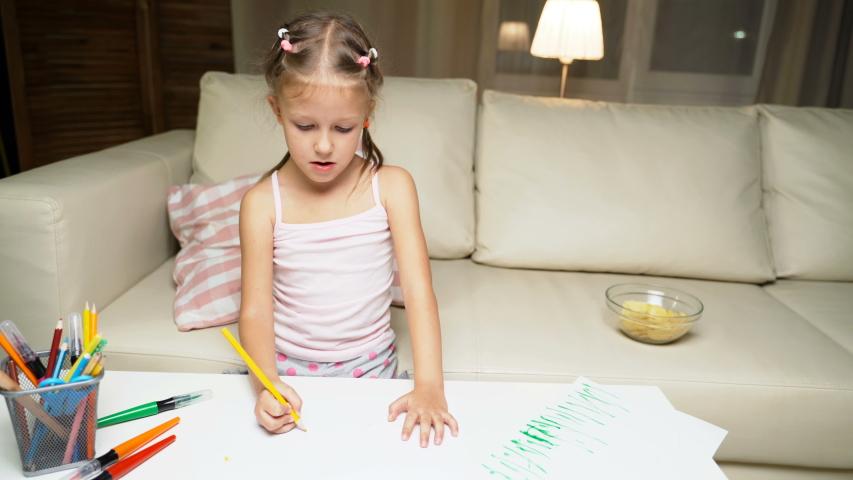 Little Girl Child Home Draws On Paper Kids Drawings   Shutterstock HD Video #1037314529
