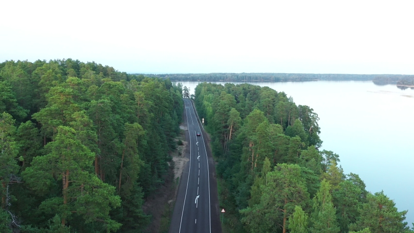 Aerial view from drone on asphalt road at the forest near lake | Shutterstock HD Video #1037327309
