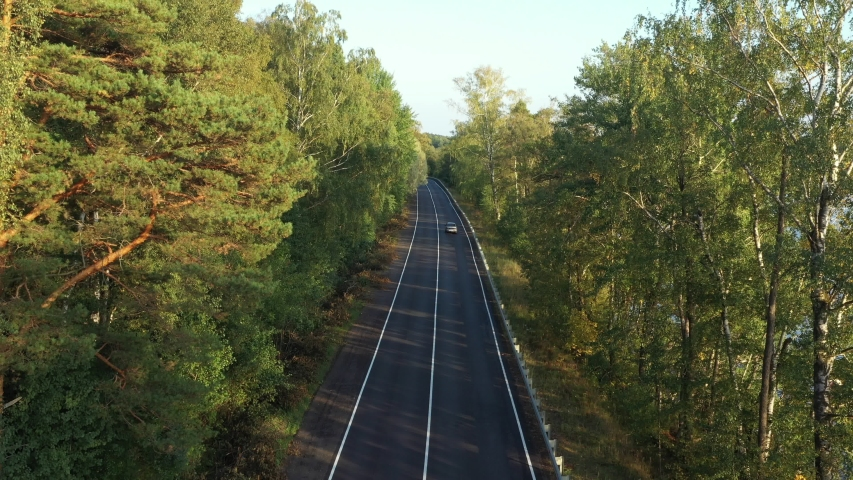 Aerial view from drone on asphalt road with cars at the forest near lake | Shutterstock HD Video #1037327339