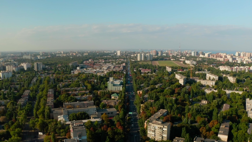 Flying over streets and moving traffic, Odessa, summer time, August 2019, Ukraine. | Shutterstock HD Video #1037370839