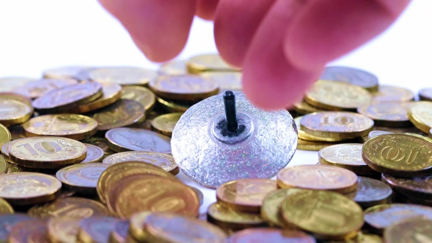 Plastic spinning top and metal coins   Shutterstock HD Video #1037388989