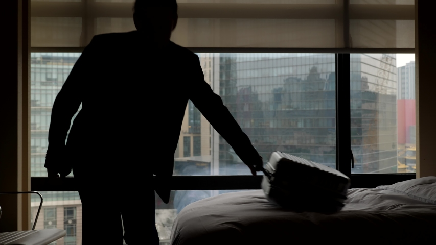 Business man check out from hotel room. Traveller take suitcase from bed and go away, super slow motion shot. Window curtain slowly move down. | Shutterstock HD Video #1037403659