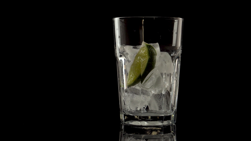 glass with tonic and lime on a black background | Shutterstock HD Video #1037751389