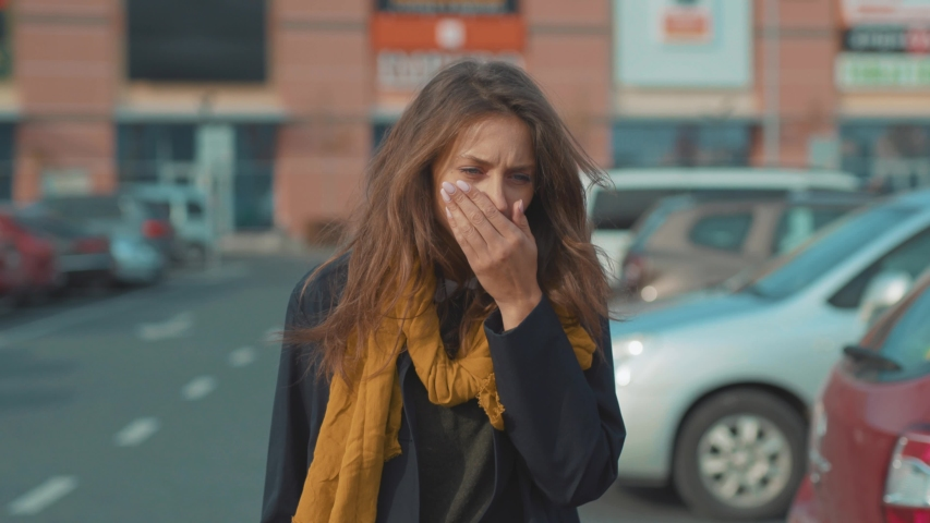 Beautiful young woman walk coughs feel sick at outdoor fever cold allergy city beautiful disease female nose sneeze lady runny tissue air pollution adult illness influenza cough district slow motion | Shutterstock HD Video #1037847959