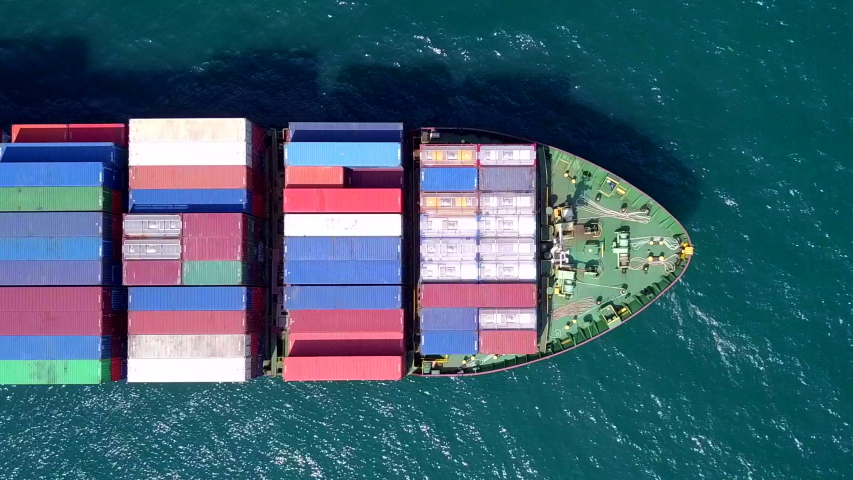 Cargo ships are sailing at sea, transporting goods all around the world. #1037968949