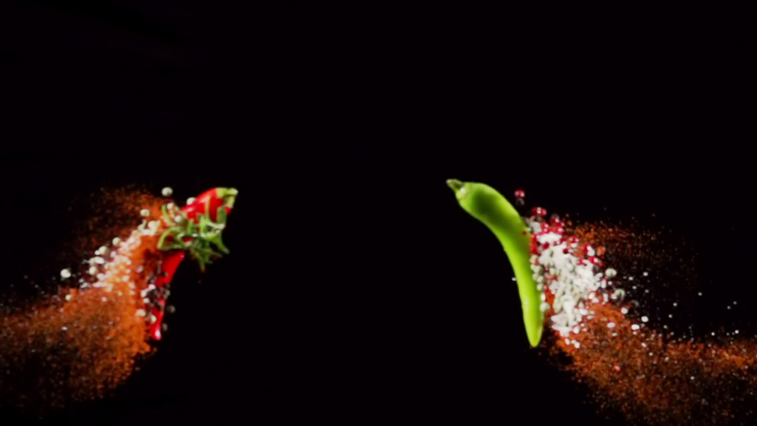 Exotic Spices paprika variation salt and peppercorn collide on black background closeup in super slow motion | Shutterstock HD Video #1038525569