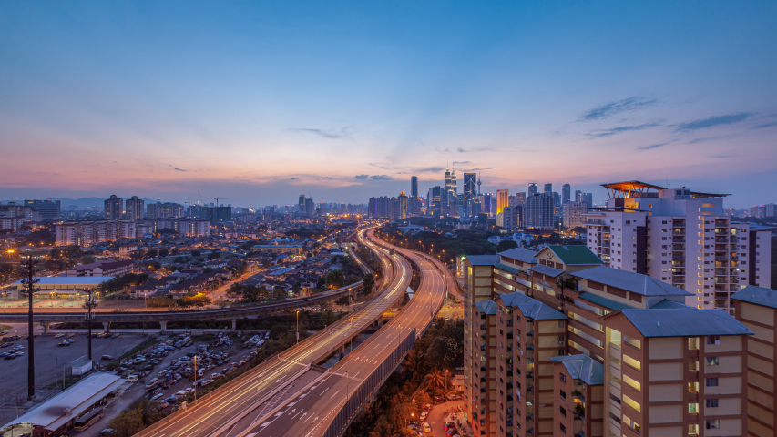 Time Lapse: Day to night of cityscape during a golden sunset overlooking an elevated highway in Kuala Lumpur city. Malaysia. 4K. | Shutterstock HD Video #1038532469