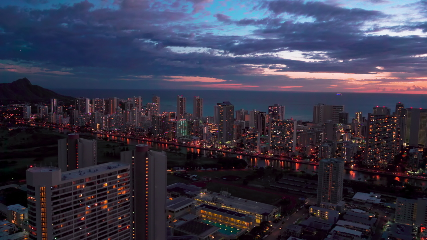 Aerial view of Ala Wai Canal an artificial waterway in Waikiki. Honolulu skyline in the background. Modern hotels, resorts and buildings. Oahu, Hawaii. Unites States. Dusk. | Shutterstock HD Video #1038548279