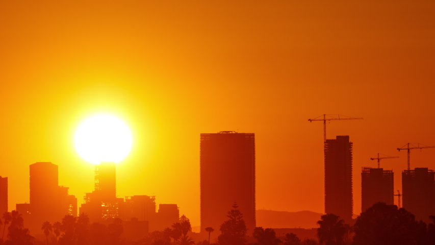 Time Lapse of the sun rising from behind downtown Los Angeles | Shutterstock HD Video #1038665609