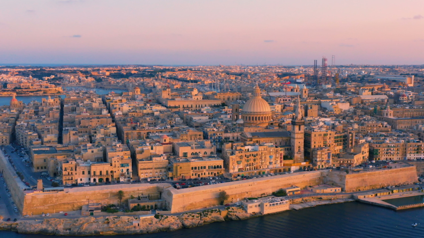 Aerial view of Valletta, Malta with Basilica of Our Lady of Mount Carmel at sunset | Shutterstock HD Video #1038688649