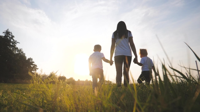Happy family funny walking go for are hold hands a teamwork Silhouette. happy little children boy and girl with mother family at sunset. mom and son mom daughter and son in white t-shirts walk on the | Shutterstock HD Video #1038699989