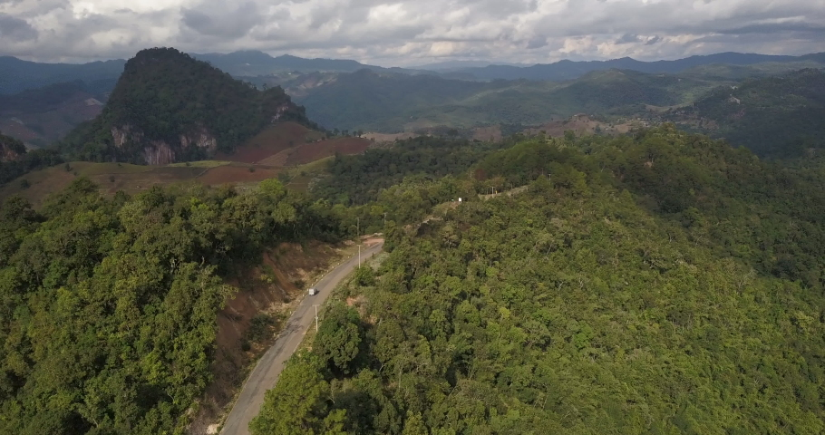 Drone flying above the beautiful mountains of Pai Mae Hong Son Northern Thailand #1038928859