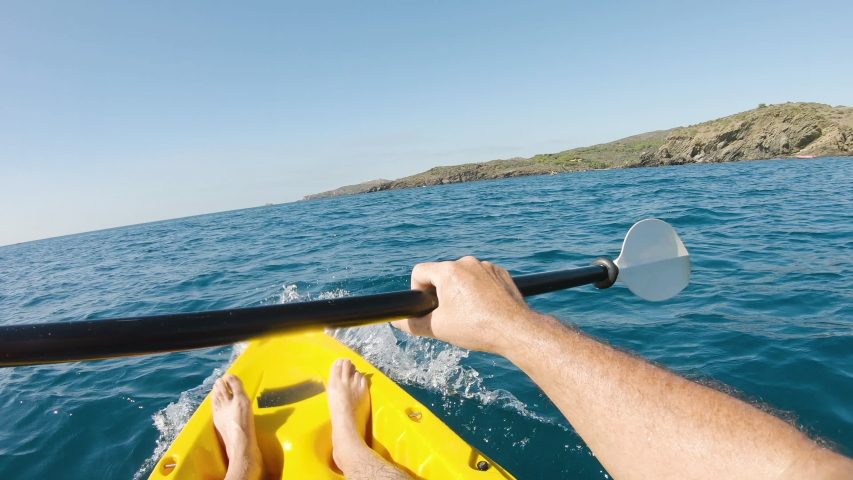 First person view kayaking with a kayak in the mediterranean sea on a sunny summer day. Concept about summer, lifestyle,wanderlust travel and nature   Shutterstock HD Video #1038974249