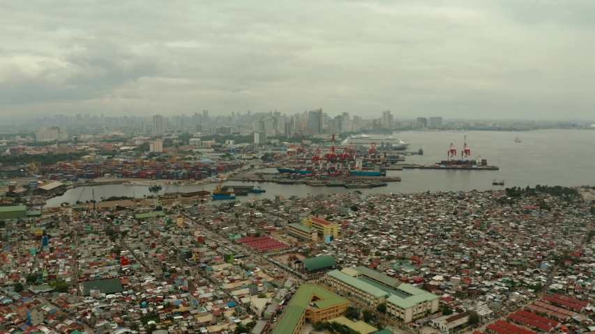 Trading port in Manila. Cargo cranes and containers in the port. Landscape. | Shutterstock HD Video #1039007159