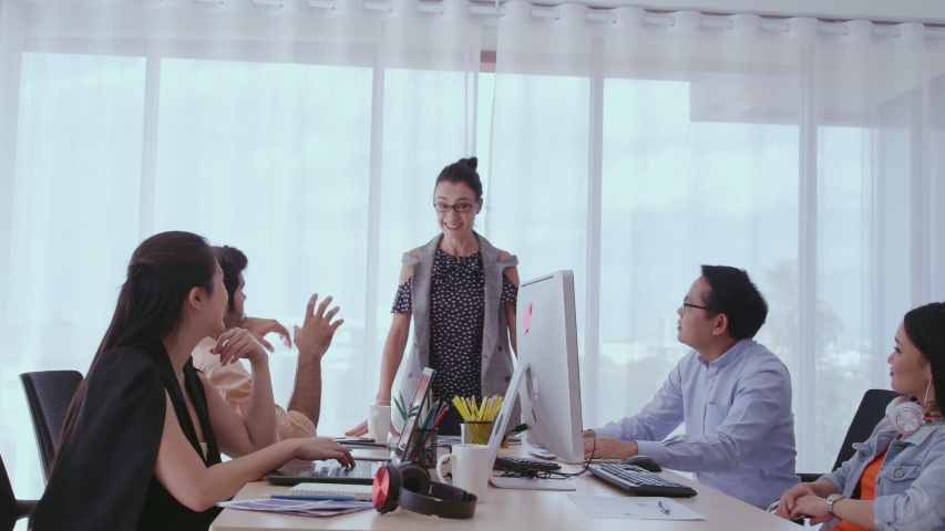 Successful business people group celebrating project success at office. Team winner and collaboration achievement concept. | Shutterstock HD Video #1039014269