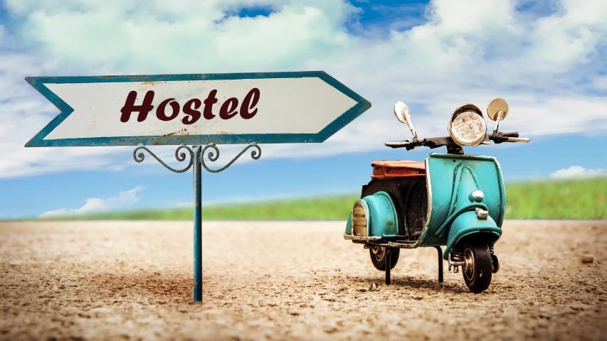 Street Sign the Way to Hostel | Shutterstock HD Video #1039108379