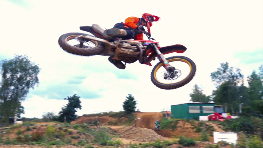 Extreme Motocross MX Rider riding on dirt track | Shutterstock HD Video #1039130819