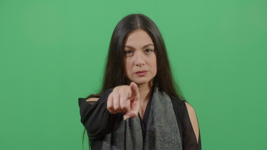 Pointing At The Camera With The Finger By A Woman. Studio Isolated Shot Against Green Screen Background | Shutterstock HD Video #1039150979